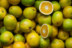 Box of Green Citrus Fruit Royalty Free Stock Photography