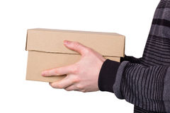 Box in hands for a man. Cardboard brown box in hands for a man Stock Photos