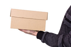 Box in hands for a man. Cardboard brown box in hands for a man Stock Photo