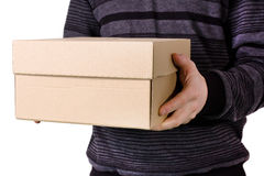 Box in hands for a man. Cardboard brown box in hands for a man Royalty Free Stock Photo