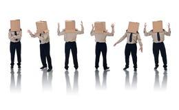 Box headed businessman with reflection. Six box headed businessman standing on white with reflection Royalty Free Stock Photos