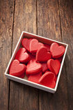 Box Love Hearts Background. A box of heart shapes on a rustic wood background Stock Photography