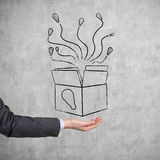 Box of ideas. Hand holding box of ideas Royalty Free Stock Images