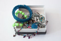 Box with jewellery. Gift box full of colorful jewelry Stock Photography