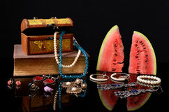 Box with jewelry, books and watermelon Royalty Free Stock Photos