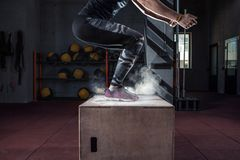Box jump workout at cross fit gym closeup stock photography