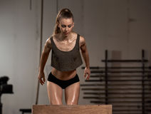 Box jumping at gym Stock Photos