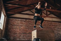 Box jumping workout at gym Royalty Free Stock Images