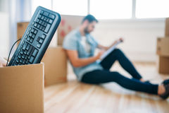 Box with keyboard, moving to new house concept Stock Photography