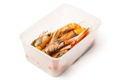 Box of langoustine isolated on a white studio background. Stock Images