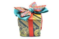 Colorful gift box with a big red-and-blue bow on a white bacground. Royalty Free Stock Images