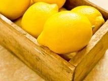 Box of Lemons. Fresh citrus, lemons in a wooden box Stock Image
