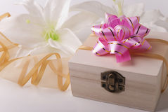 Box and lily Royalty Free Stock Images