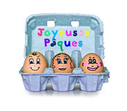 Box of little people eggs joyeuses paques Royalty Free Stock Photos