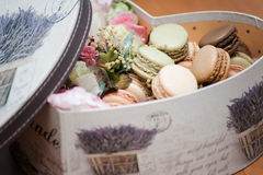 Box of macaroons and flowers Stock Photo
