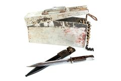 Box with a macine-gun tape and bayonet-h Royalty Free Stock Images
