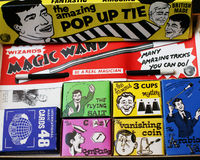 Box of Magic Tricks. A box of childrens magic tricks including a magic wand cards cups and balls vanishing coin and pop up tie Royalty Free Stock Photos