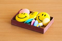 Box with magnetic smiles on tabletop Royalty Free Stock Images