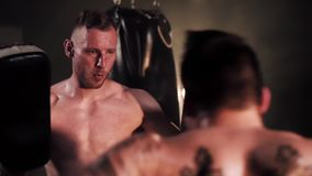 Box. Male boxer training with coach stock footage