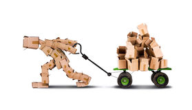 Box character moving boxes on trolley Stock Image