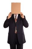 Box man reveal. Businessman about to reveal himself from his hidden identity Stock Photo