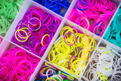 Box with many colorful rubber bands for rainbow loom Royalty Free Stock Photo