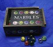 Box of marbles. Wooden box of marbles to play with royalty free stock photo