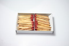 Box of matches. A box of matchsticks divided into two halves over white background Royalty Free Stock Photography