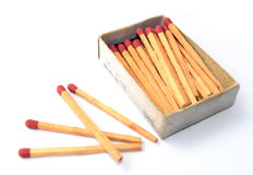 The box of matches and the other 4 matches outside the box Stock Image