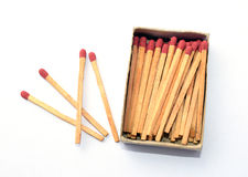 The box of matches and the other 4 matches outside the box royalty free stock photo