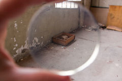 Box in mess throught transparent lens Royalty Free Stock Photos