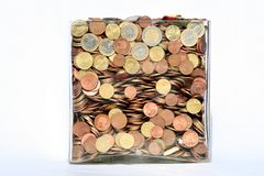 Box of money. Glass box full of euro coins isolated white background Stock Image