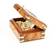 Box with money and jewelry Royalty Free Stock Image
