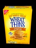 A Box of Nabisco Wheat Thins on a Black Backdrop Royalty Free Stock Photos