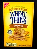 A Box of Nabisco Wheat Thins on a Black Backdrop Stock Photo