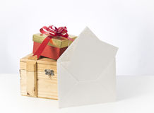 Box and note. Gift box and note on white background Stock Image