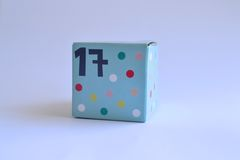 Box with number seventeen. Spotty patterned cardboard box with the number seventeen printed on it Royalty Free Stock Photo