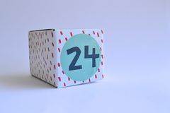 Box with number twenty four. Blue and red patterned cardboard box with the number twenty four printed on it Stock Photo