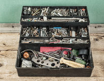 Box of odds and ends. Box with tools and sundries Royalty Free Stock Image