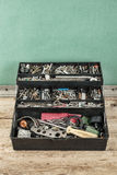Box of odds and ends. Box with tools and sundries Royalty Free Stock Photo