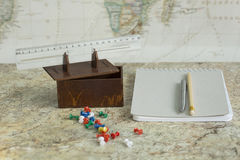Box office supplies. Stationery box and a ruler on a background map of the world stock photos