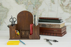 Box office supplies. On world map background stock photos