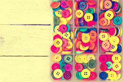 Box of olorful sewing buttons Royalty Free Stock Photo
