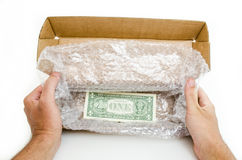 Box order with the dollar bill Stock Images
