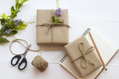 Box package parcel prepare send to customer. Scissors ,rope ,notebook and box package parcel prepare send to customer with flower arrangement flat lay style on royalty free stock photography