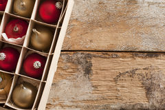 Box of packaged gold and red Xmas ornaments Stock Photo