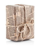 Box packaged newspaper with bow of rope Royalty Free Stock Photography