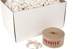 Box of packing peanuts with roll of fragile tape Royalty Free Stock Image