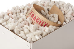 Box of packing peanuts with roll of fragile tape Royalty Free Stock Photo