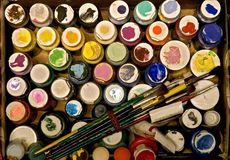 Box Of Paint. A cardboard box full of an artists paints and brushes Royalty Free Stock Photography